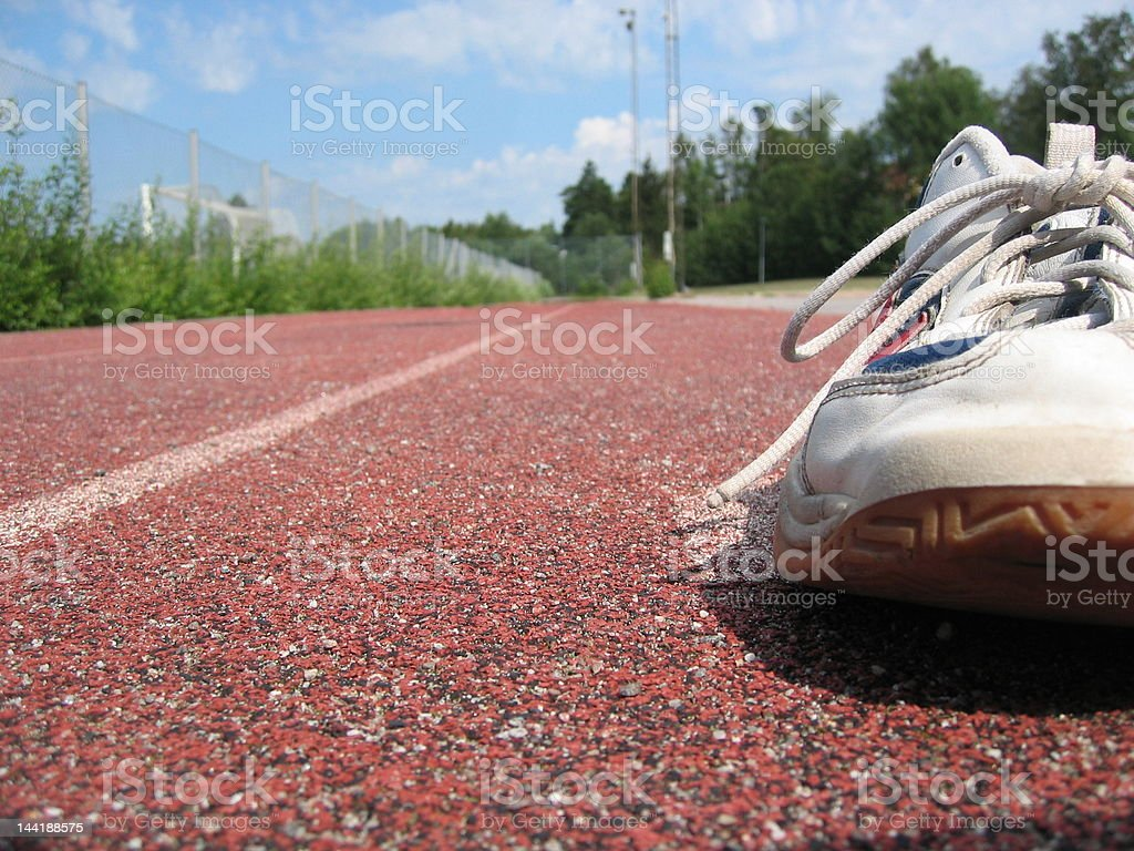 shoe on a racetrack royalty-free stock photo