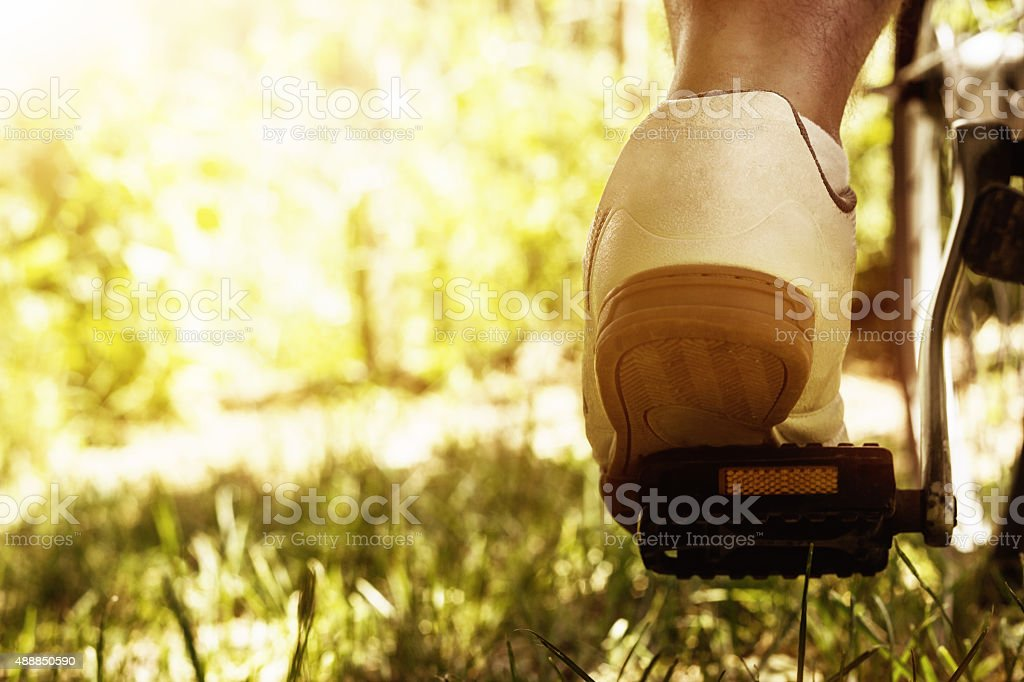 shoe on the bike pedal stock photo