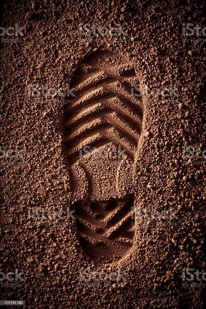 Shoe print in the soil stock photo