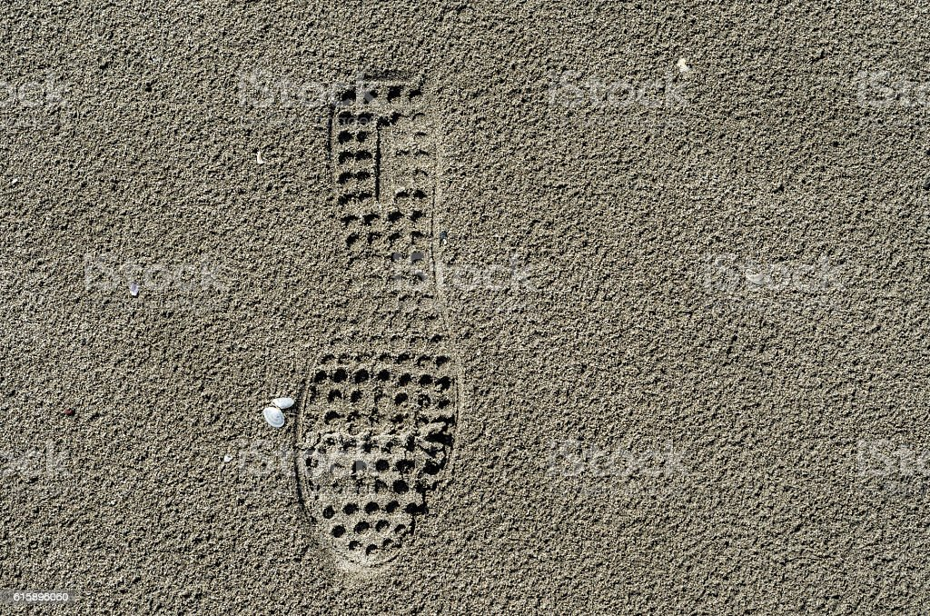 Shoe print on the sand stock photo