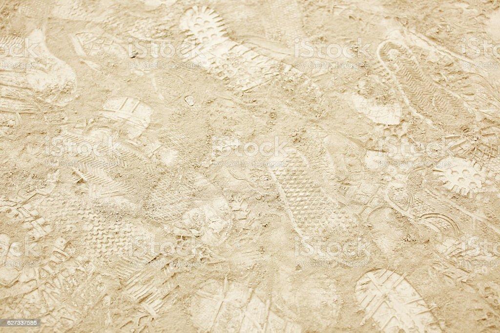 Shoe prints on dusty ground stock photo