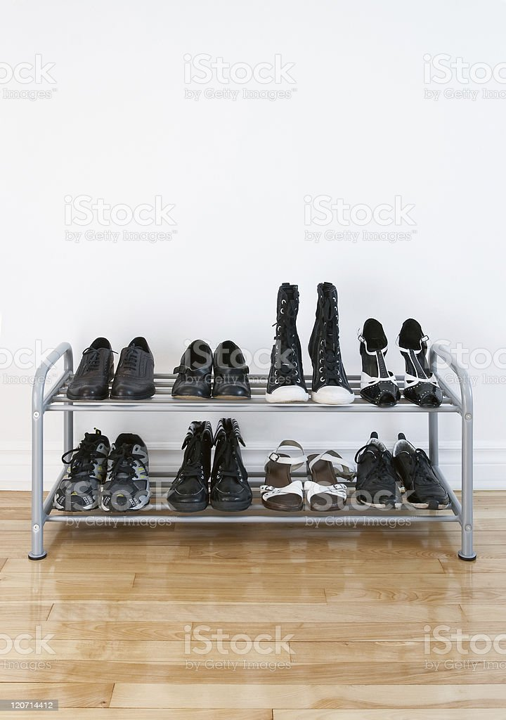 Shoe rack on a wooden floor royalty-free stock photo