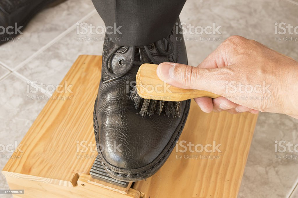 shoe shiner working at his workplace stock photo