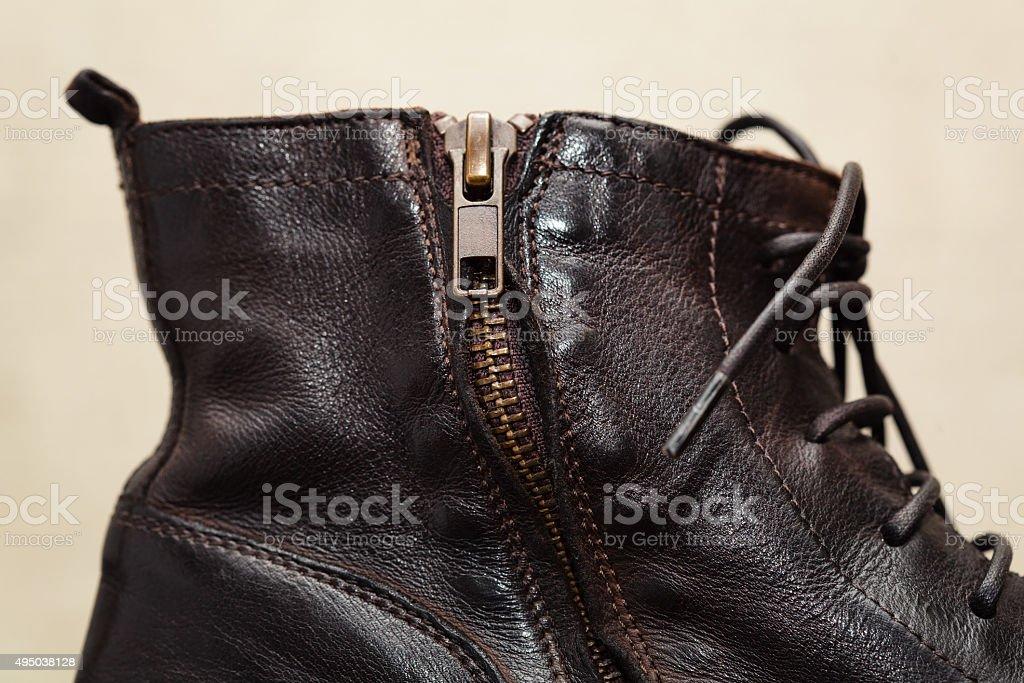 Shoe zipper, laces close up. High leather shoes stock photo