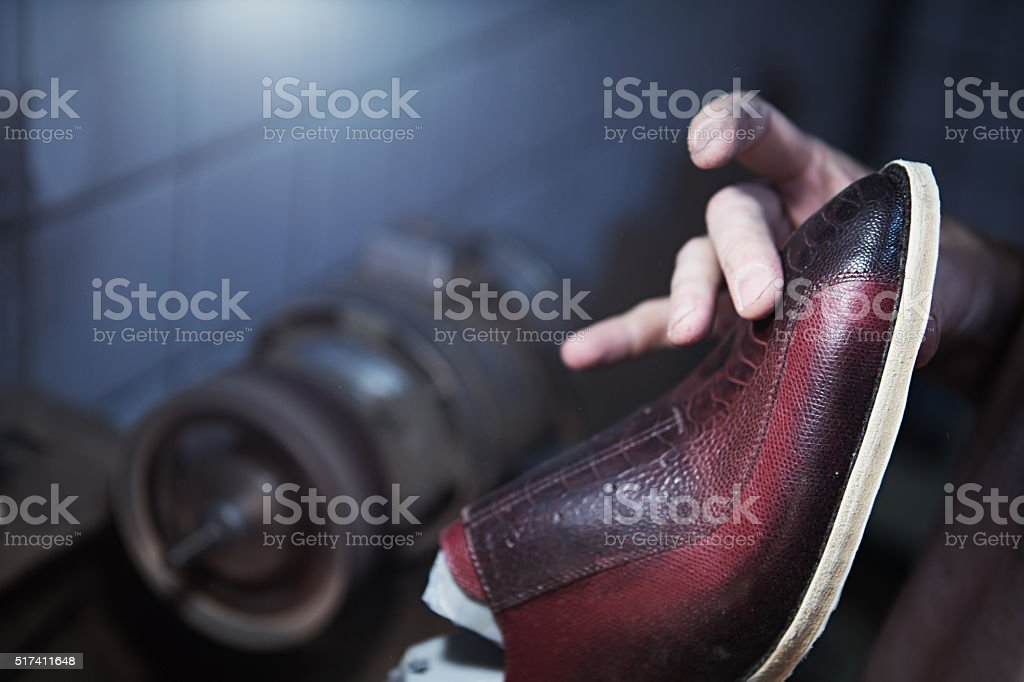 shoemaker makes shoes for men stock photo