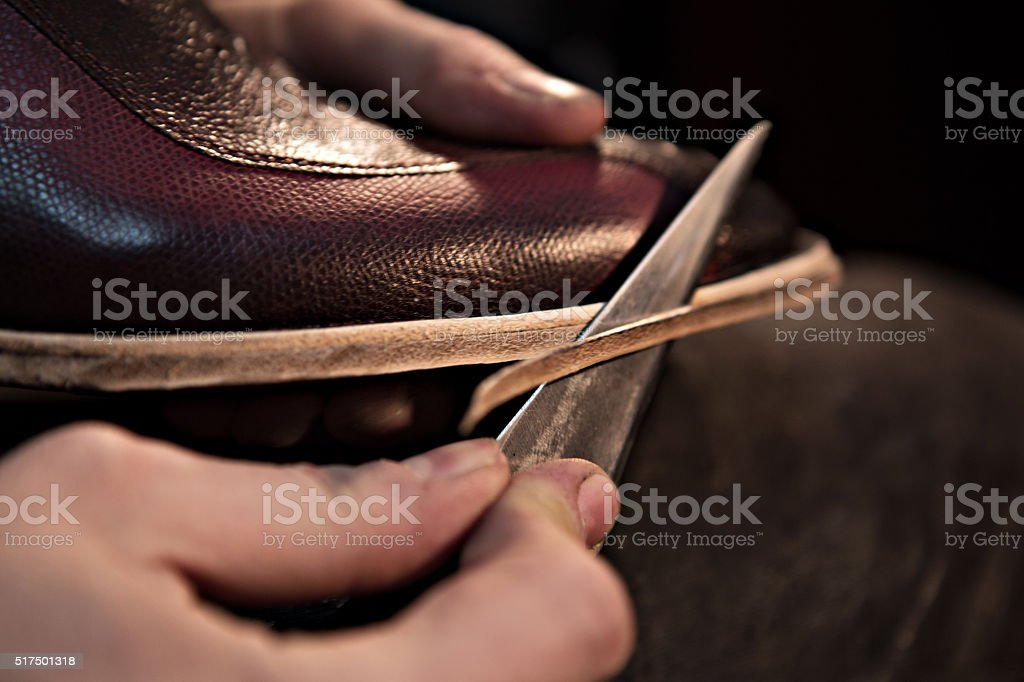 Shoemaker makes shoes for men. stock photo