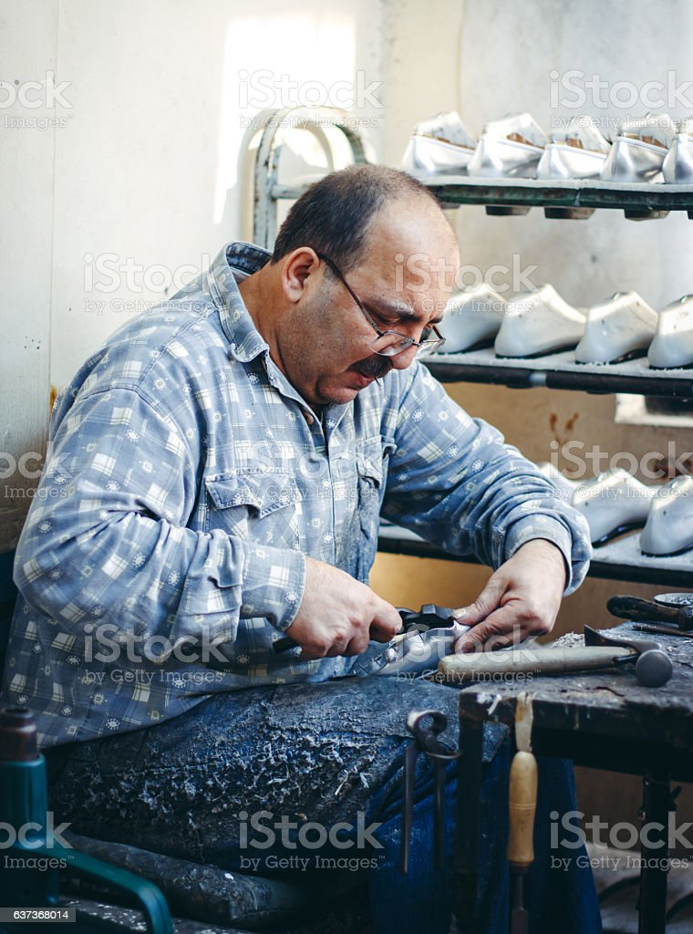 Shoemaker manufactures the a shoe stock photo