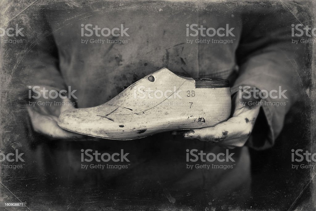 Shoemaker or Cobbler With His Tools of the Trade royalty-free stock photo