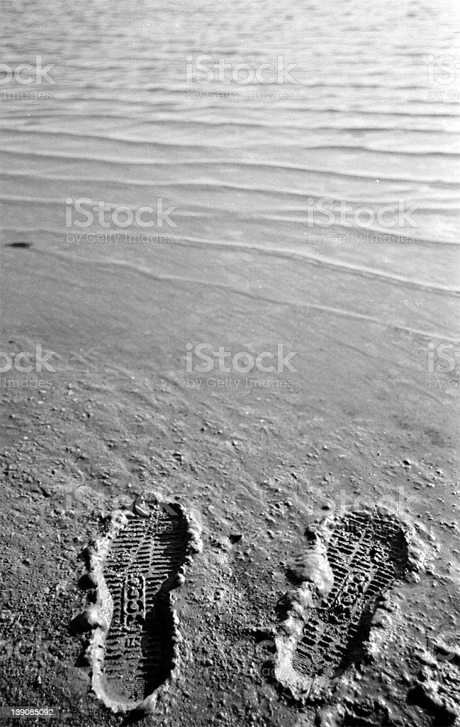 A shoemark in the sand of the lake royalty-free stock photo