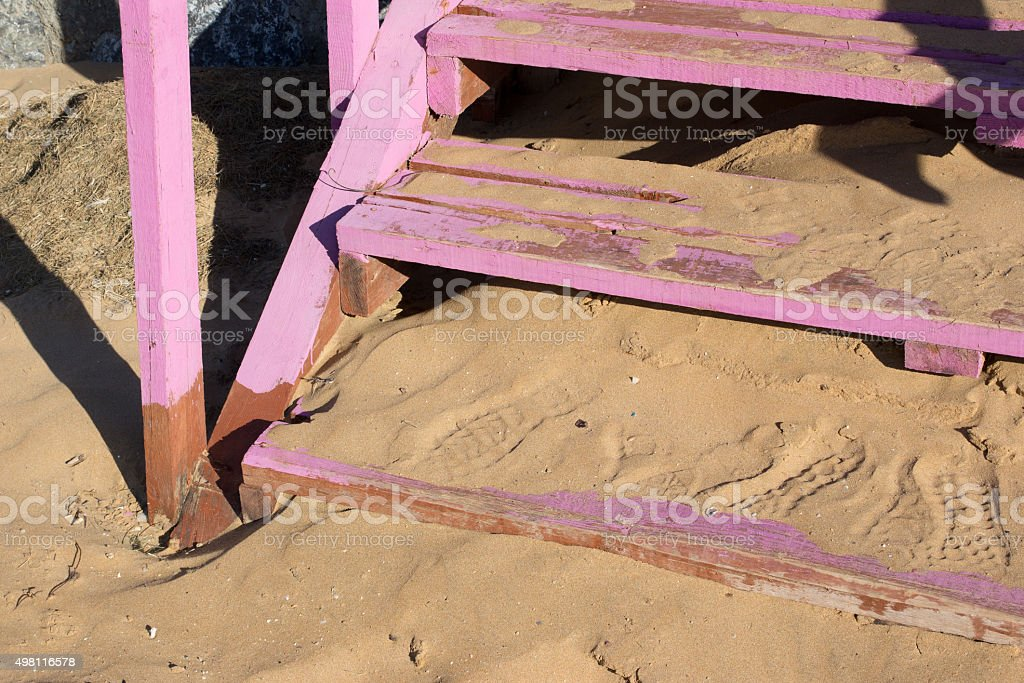 shoeprints on wooden steps stock photo