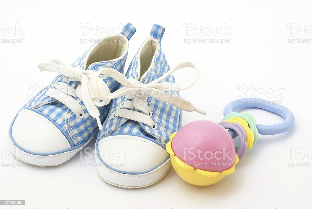 Shoes and rattle stock photo