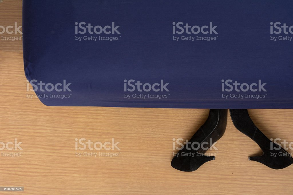 Shoes beside bedside stock photo