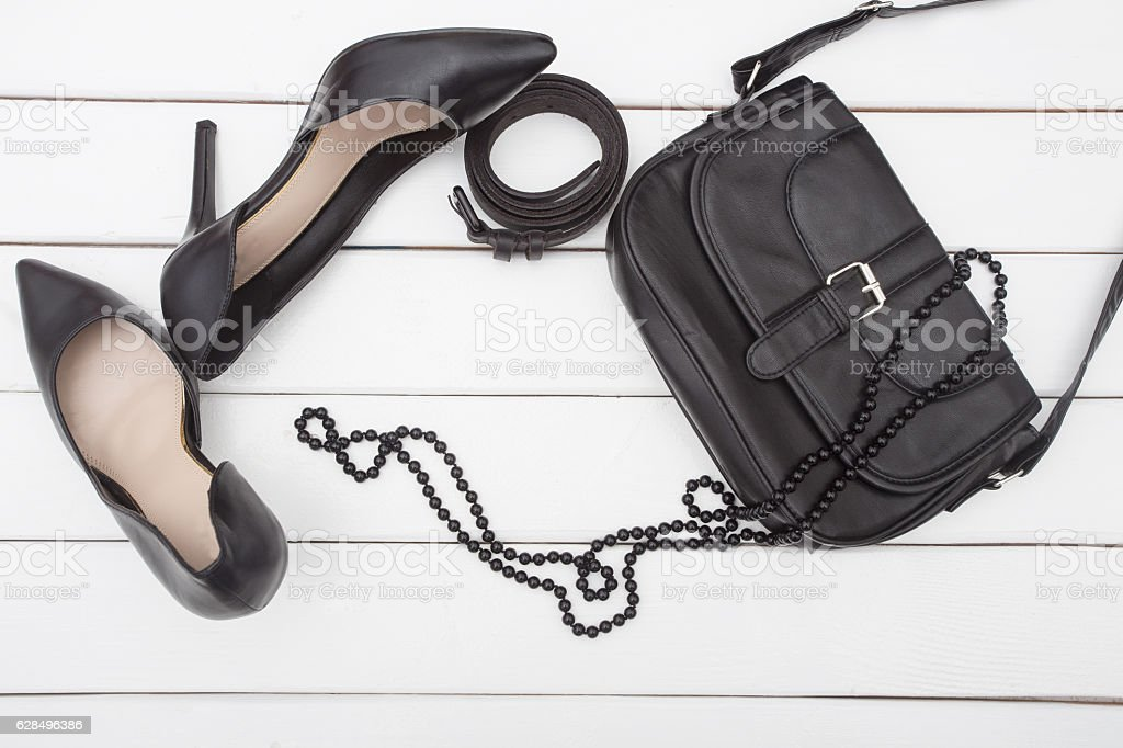 shoes  fashion handbag and pearl necklace stock photo