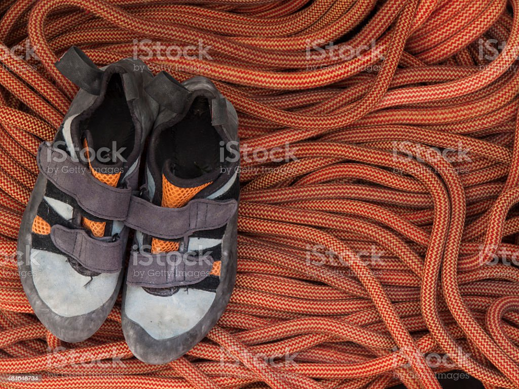 Shoes for mountaineering and rock climbing is on the rope. stock photo