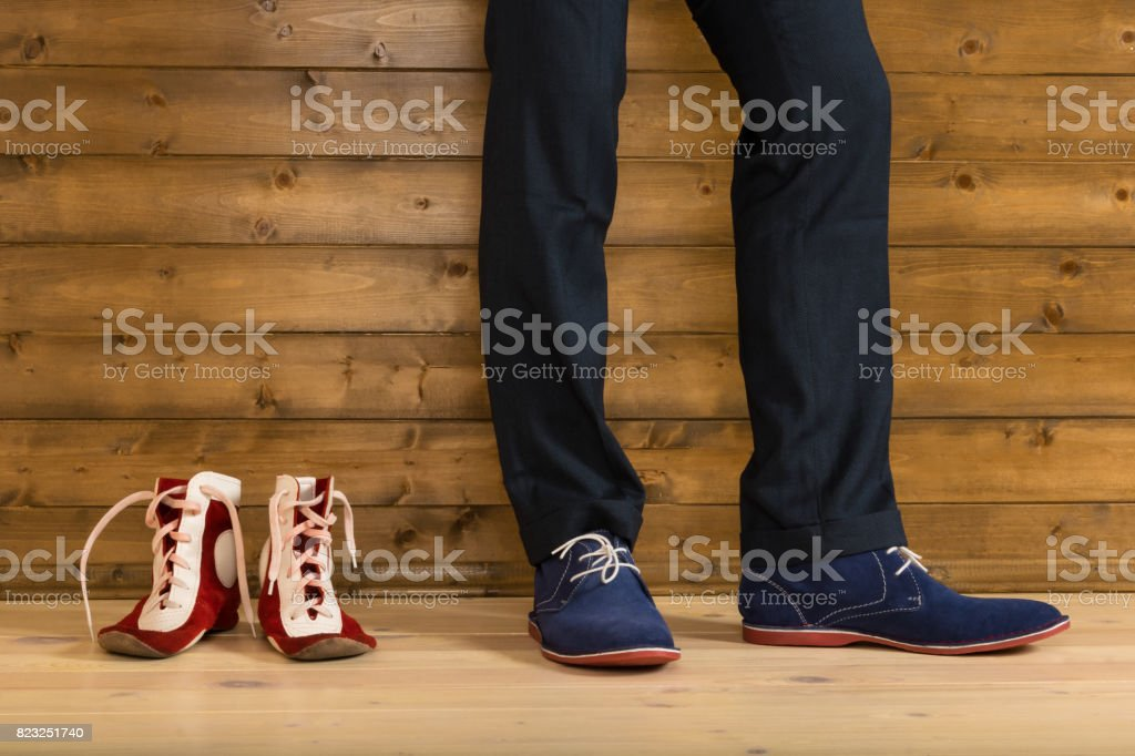 Shoes for wrestling in the corner next to the athlete in trousers stock photo