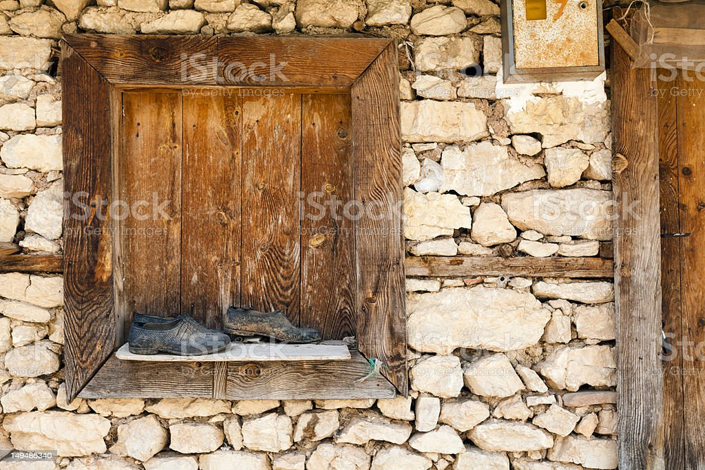 shoes front of old window stock photo