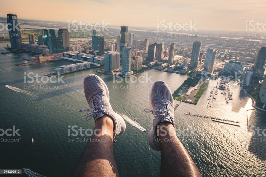 Shoes hanging out over the Hudson River royalty-free stock photo