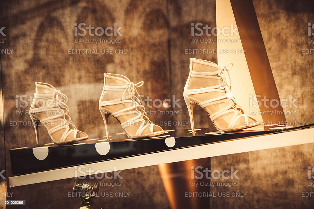 Shoes in a shop window in VIa Montenapoleone stock photo