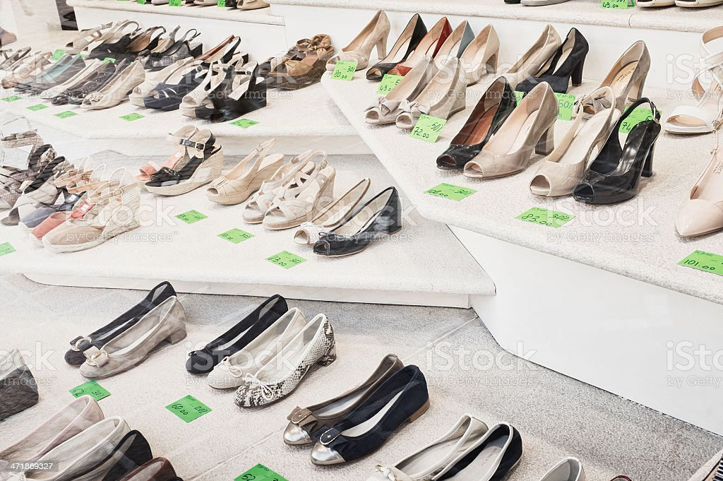 Shoes in a shop window with sales royalty-free stock photo