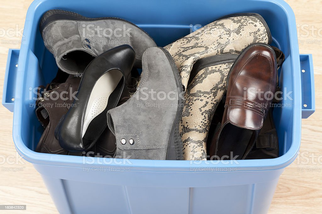 Shoes in Plastic Storage Box royalty-free stock photo