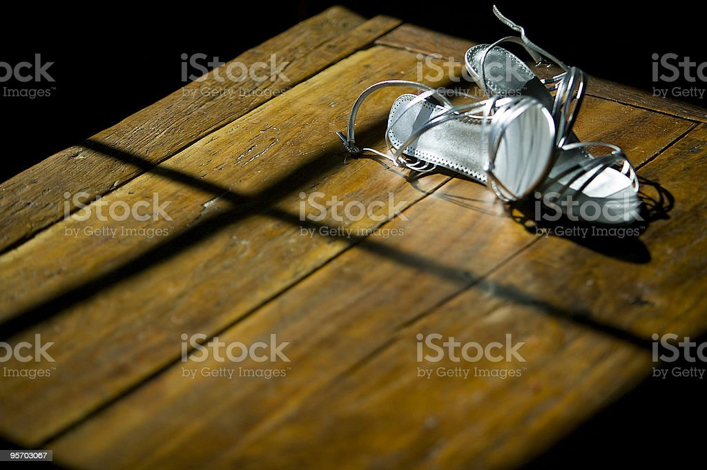 Shoes left on table royalty-free stock photo