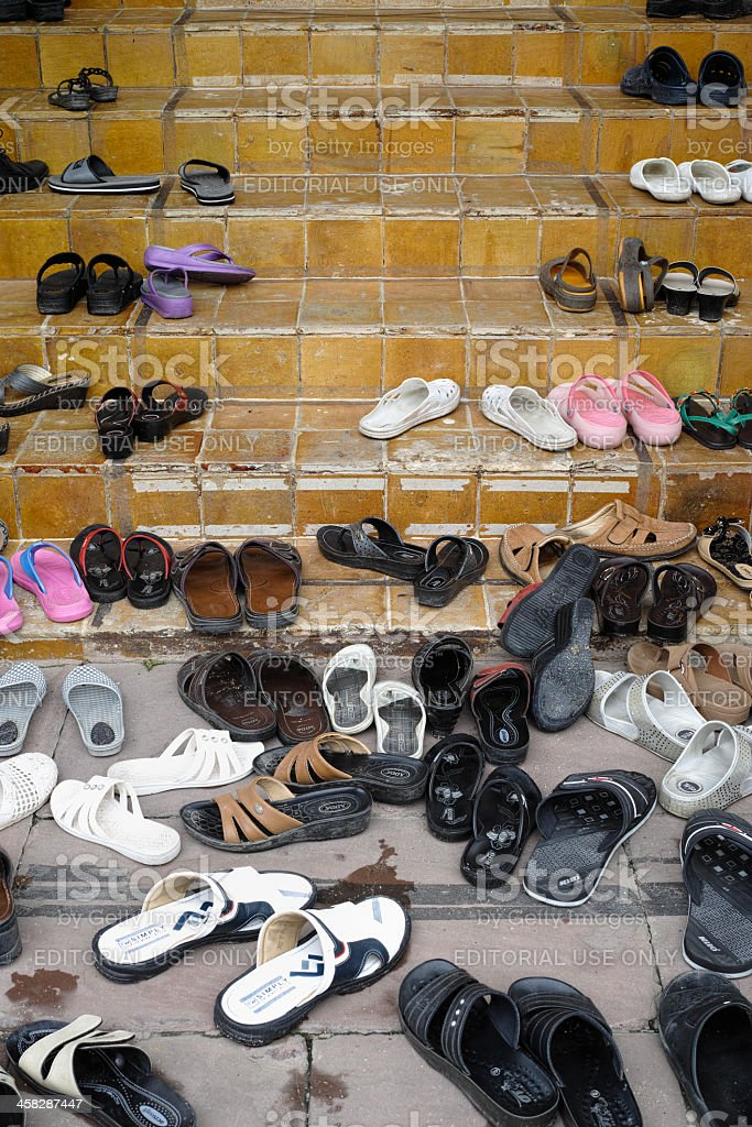 Shoes left outside a Buddhist temple. royalty-free stock photo