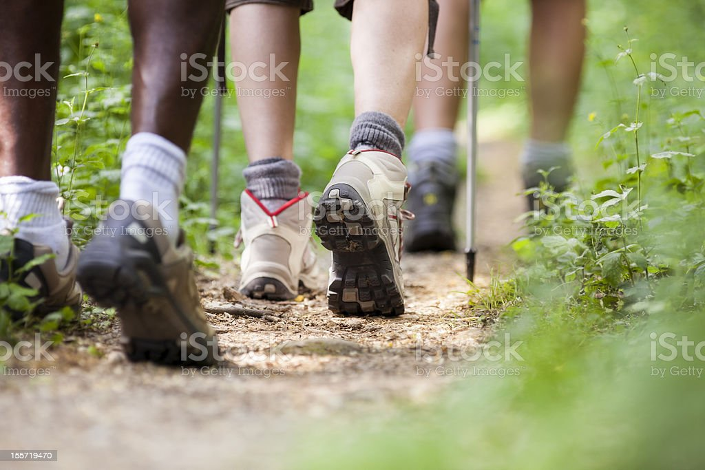 shoes of people trekking and walking in row stock photo