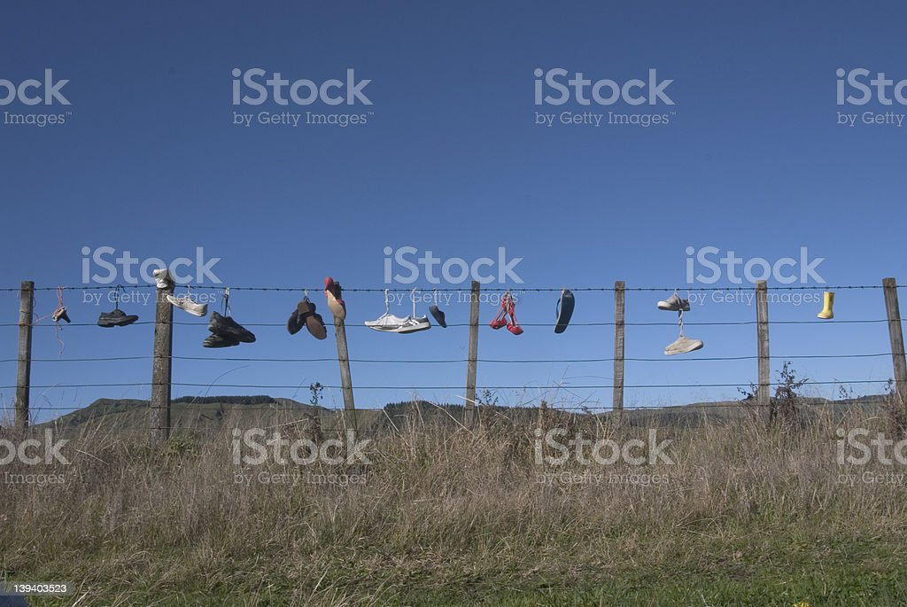 Shoes On Fence royalty-free stock photo