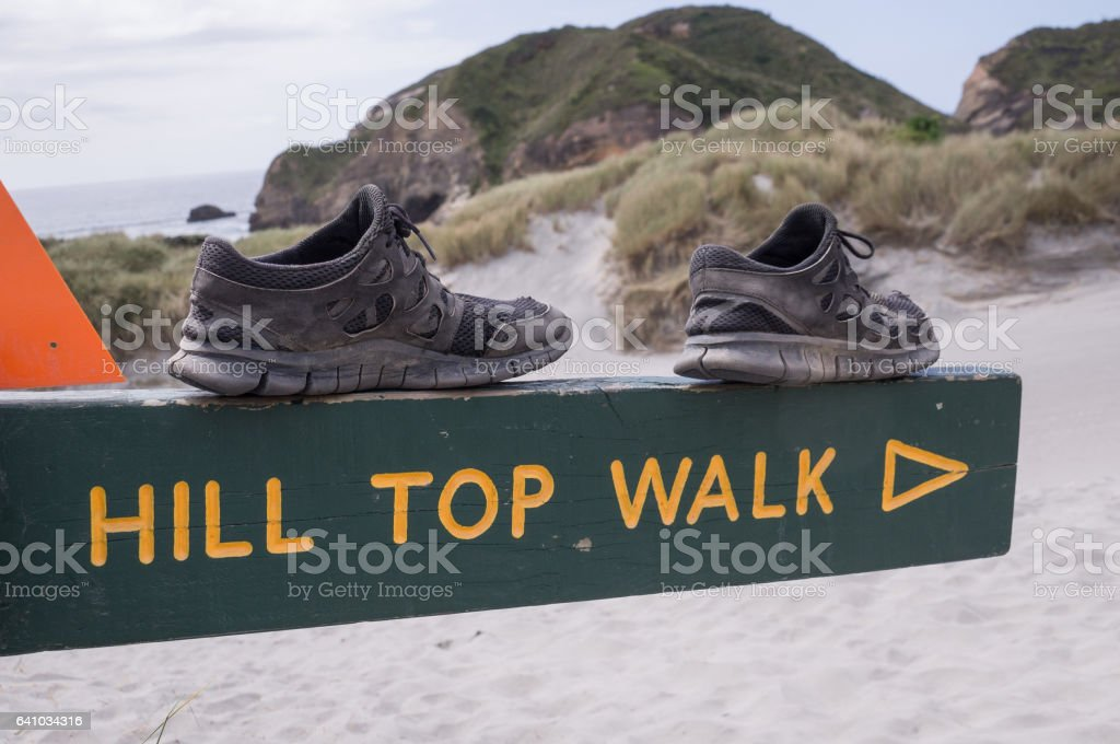 Shoes on sign reading 'Hill Top Walk' stock photo