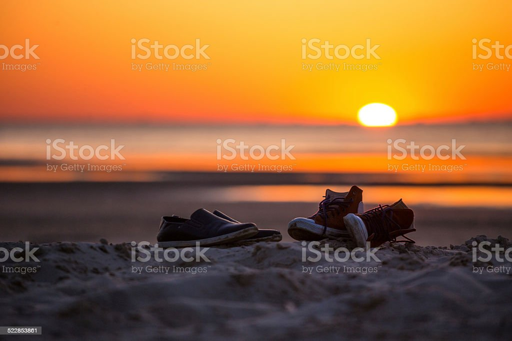 shoes on the sand royalty-free stock photo