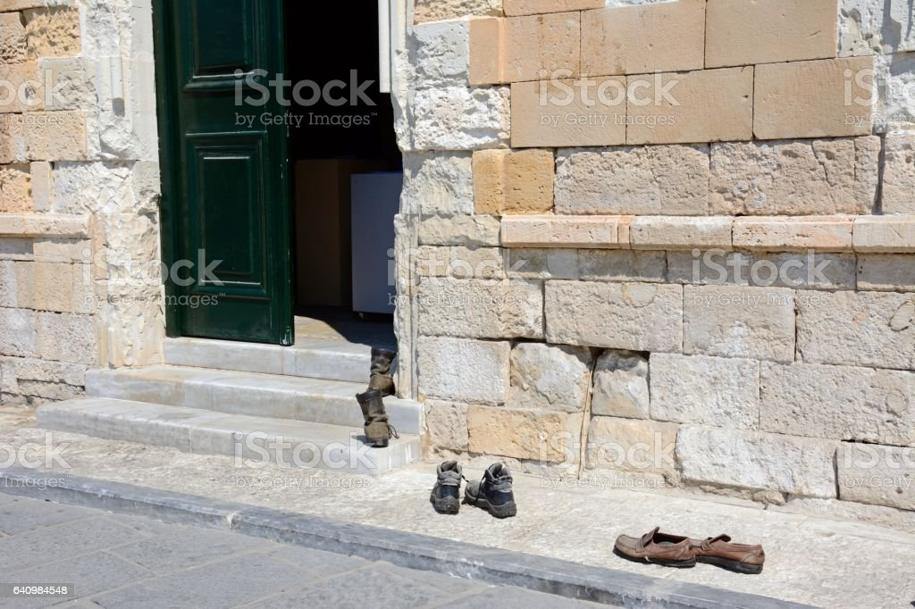 Shoes outside the entrance to the Turkish mosque, Chania. stock photo