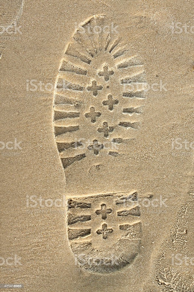 shoes print on sand stock photo