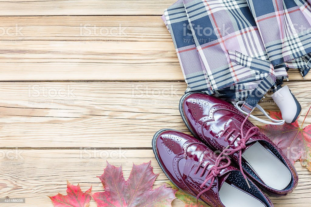 Shoes, umbrella and autumn leaves stock photo