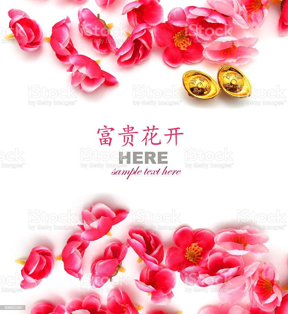Shoe-shaped gold ingot (Yuan Bao) and Plum Flowers stock photo