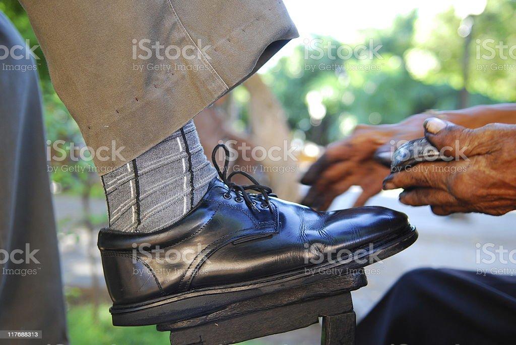 Shoeshiner at work - Granada, Nicaragua royalty-free stock photo