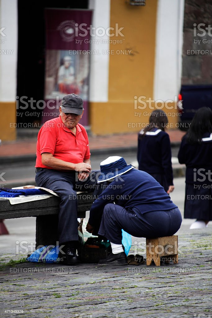 Shoeshiner in Quito stock photo