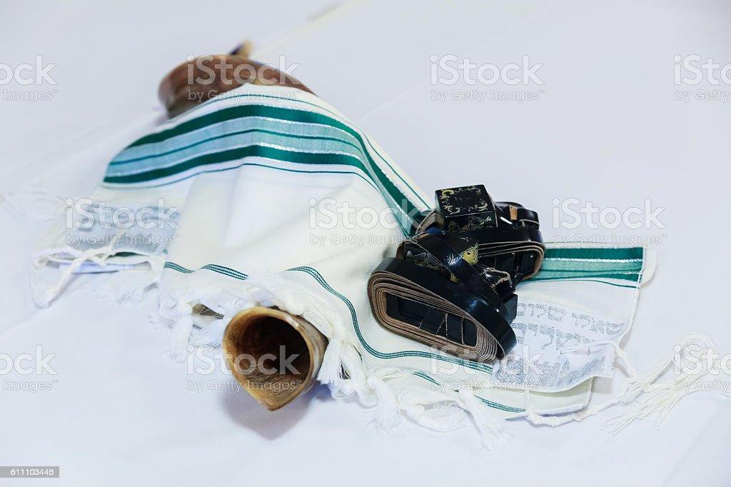 shofar horn on white prayer talit. rosh hashanah stock photo