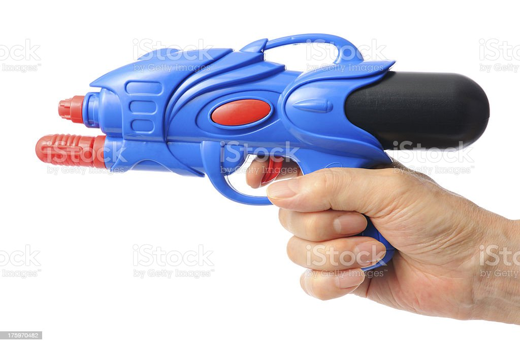 Shoot with a blue squirt gun against white background royalty-free stock photo