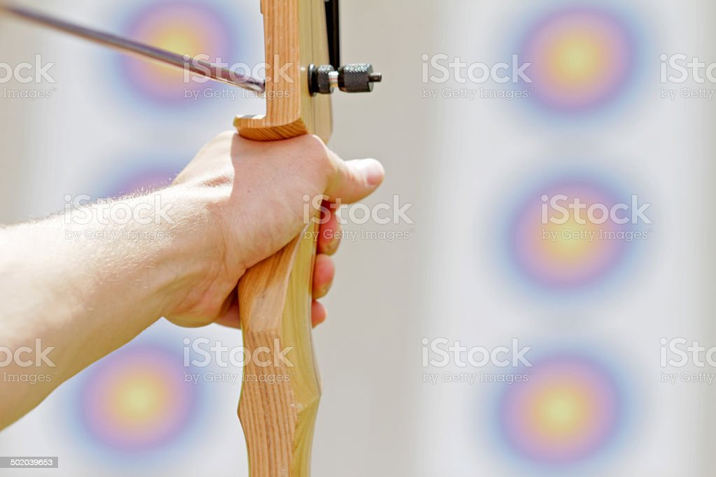 Shoot with bow and arrow stock photo