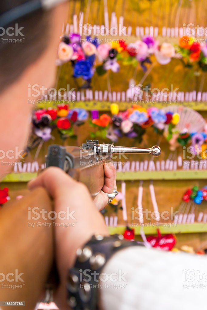 Shooter at a Shooting Gallerie stock photo