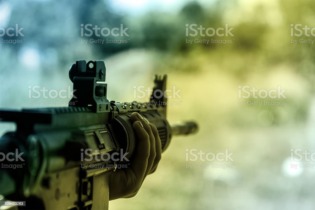 shooter sighting in the target. stock photo