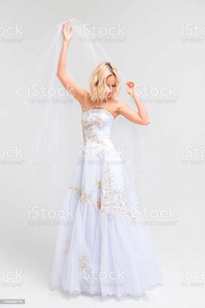 shooting a bride in a wedding dress in the studio stock photo