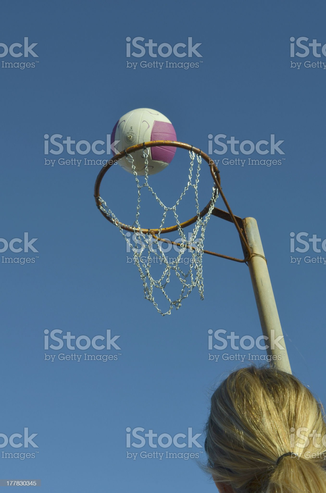 Shooting a Netball Goal royalty-free stock photo