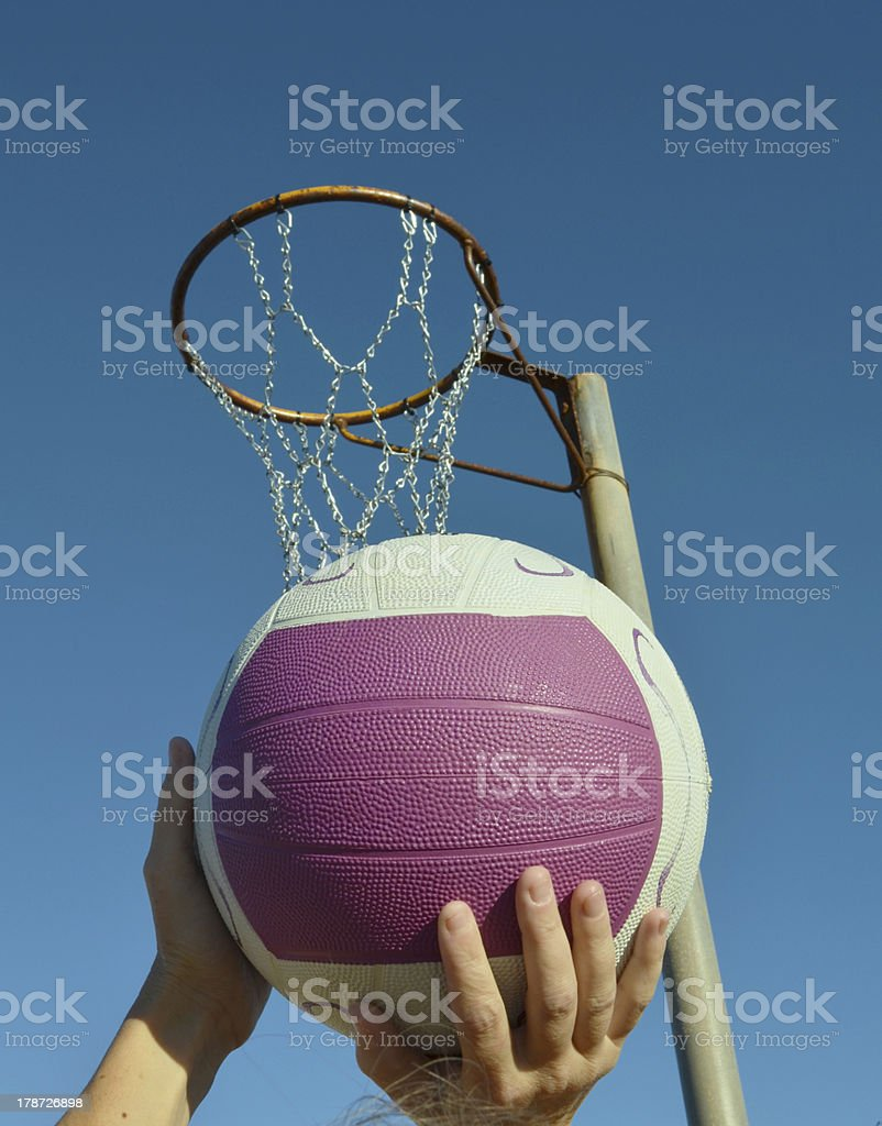 Shooting a netball goal royalty-free stock photo