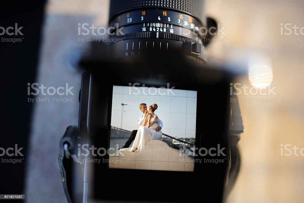 Shooting a wedding with a vintage camera stock photo