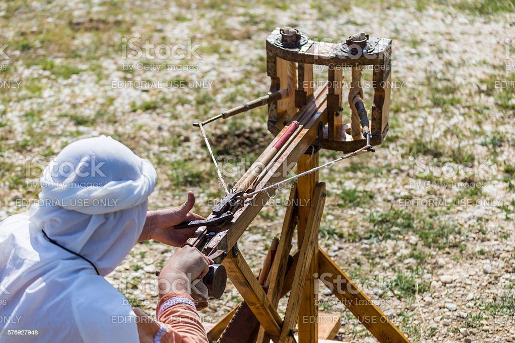 Shooting arrows from a ballista stock photo