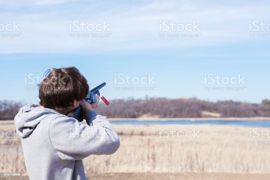 shooting clay pigeons in open field during spring stock photo