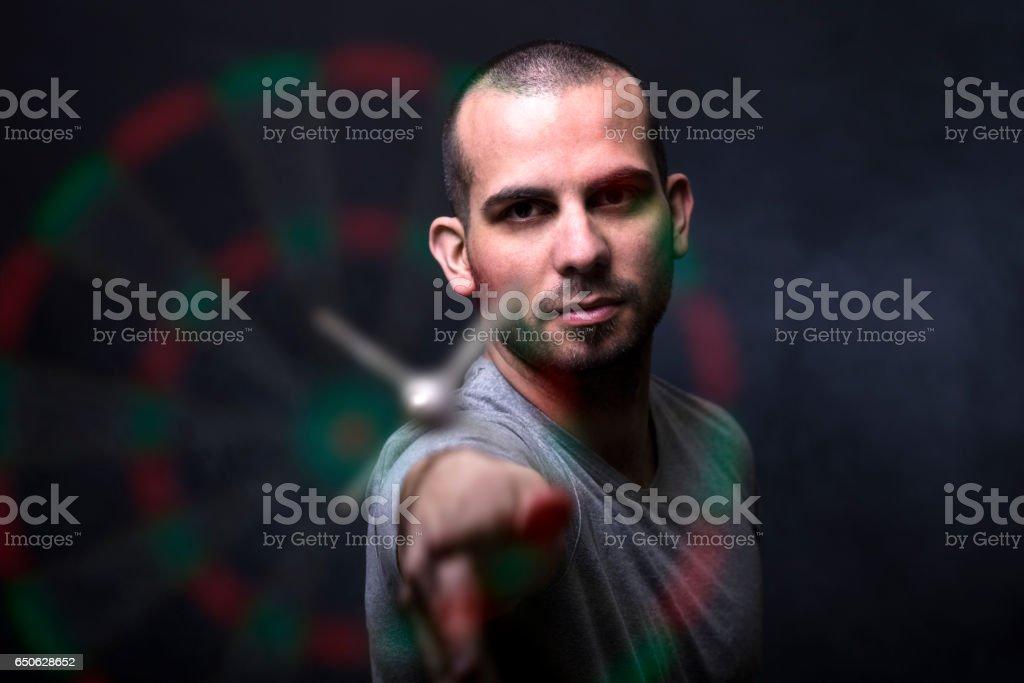 Shooting darts stock photo