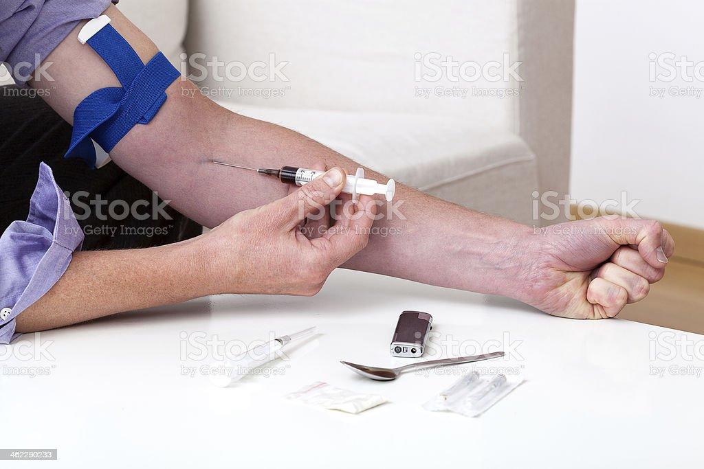 Shooting heroin stock photo