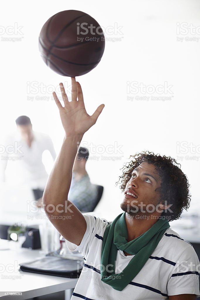 Shooting hoops after work royalty-free stock photo